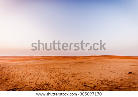 Dramatic sunrise view of Liwa Desert in the western region of Abu Dhabi - stock photo