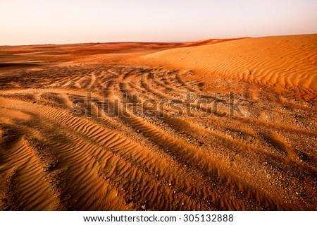 Dramatic sunrise view of Liwa Desert in the western region of Abu Dhabi, UAE - stock photo