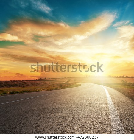 dramatic sunset and asphalt road