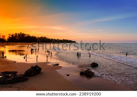 dramatic sunset and blue sky during twilight time at the beach - stock photo