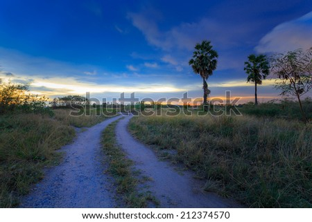 Dramatic sunset and the clay road at Rayong east of Thailand - stock photo