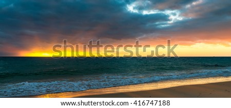 Dramatic sunset at the beach. Christies Downs, South Autralian coast. Color-toning effects applied - stock photo
