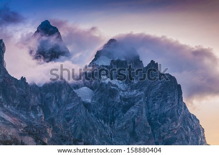 Dramatic Sunset Clouds over the mountain peaks - Grant Tetons