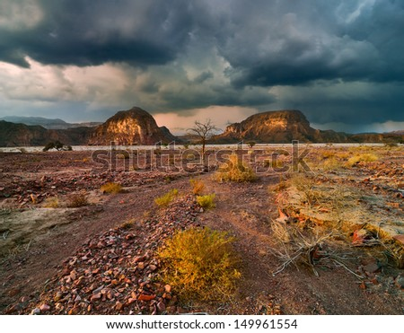 Dramatic sunset in the desert of Israel. - stock photo