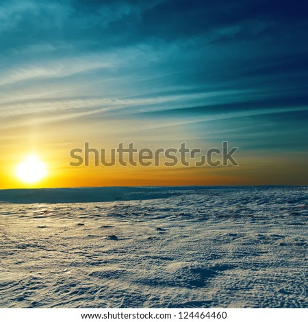 dramatic sunset in winter. Winter landscape - stock photo