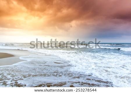 Dramatic Sunset on the Beach - stock photo