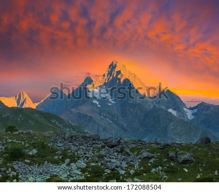 dramatic sunset over a mountains - stock photo
