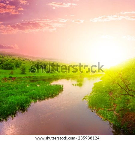 dramatic sunset over a river - stock photo