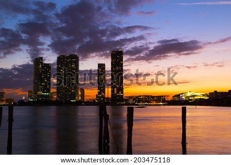 Dramatic sunset over Miami city downtown. Urban landscape and calm waters at sunset. - stock photo