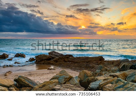 Dramatic sunset over rocky beach, South Australia