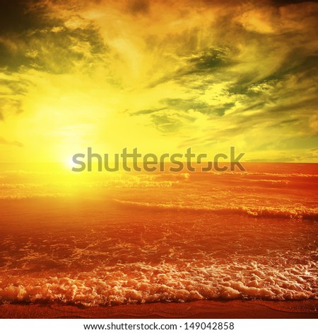 Dramatic sunset over sea. - stock photo