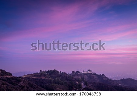 Dramatic sunset over the hills of Los Angeles - stock photo