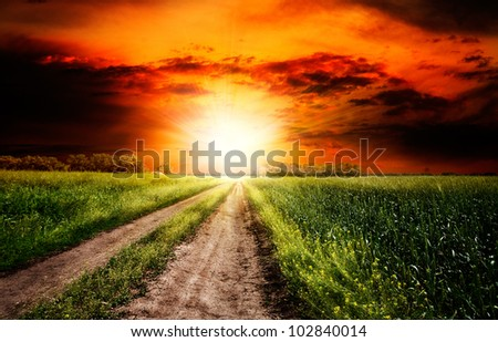 Dramatic sunset over the rural landscape - stock photo