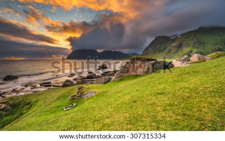 Dramatic sunset over Uttakleiv beach on Lofoten islands in Norway. Hdr processed. - stock photo