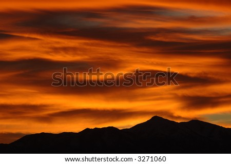 Dramatic sunset picture over mountains, Salt Lake Valley, Utah - stock photo