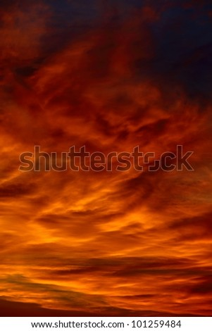Dramatic sunset sky with clouds glowing red - stock photo