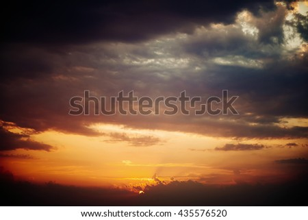 Dramatic sunset sky with orange colored clouds - stock photo