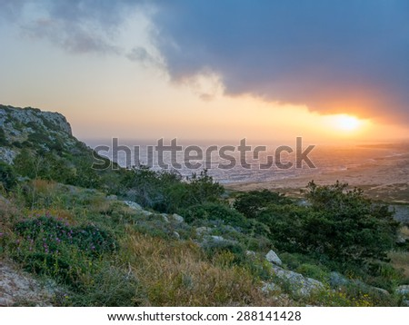 Dramatic sunset with storm cloudscape over Mediterranean Sea and coastline. Cape Greko, Cyprus.  - stock photo