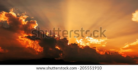 dramatic Sunset with sun rays through clouds