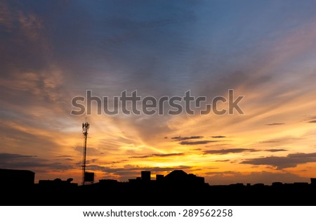 Dramatic twilight sky over silhouetted cityscape