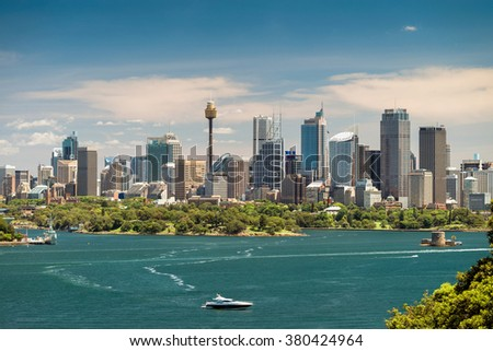 Dramatic view at Sydney city urban skyline from Western Plains with blue sky and clouds on a bright day - stock photo