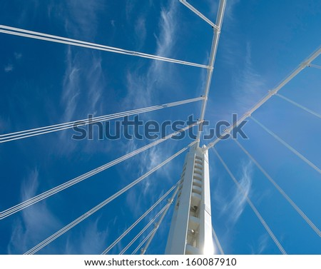 Dramatic view from below of the new east span of the San Francisco-Oakland Bay Bridge - stock photo