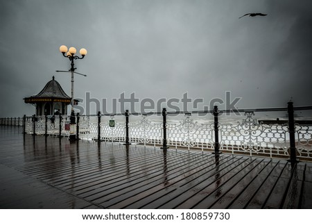 Dramatic view from Brighton pier during rainy day - stock photo