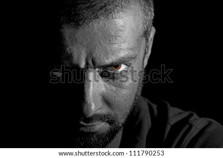 Dramatic view of a man face in darkness