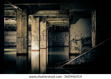 Dramatic view of damaged and abandoned building sunken by rain flood waters. Apocalyptic and evil concept - stock photo