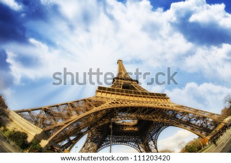 Dramatic view of Eiffel Tower with Sky on Background, Paris