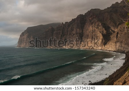 Dramatic view of monumental Los Gigantes cliffs on shore of Tenerife, Canary Islands. - stock photo