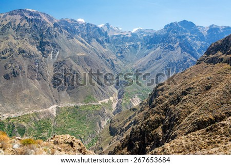 Dramatic view of the steep walls of Colca Canyon in Peru - stock photo