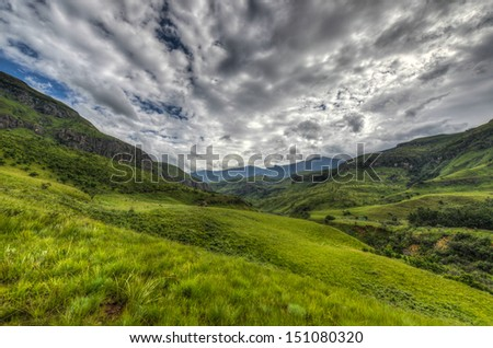 Dramatic views of the hills of the Drakensberg Range in the Giants Castle Game Reserve, KwaZulu-Natal, South Africa. - stock photo