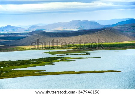 Dramatic volcanic crater Hverfjall near the lake Myvatn, Iceland - stock photo