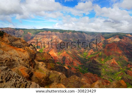 Dramatic Waimea Canyon on the island of Kauai, Hawaii, with waterfall in far background
