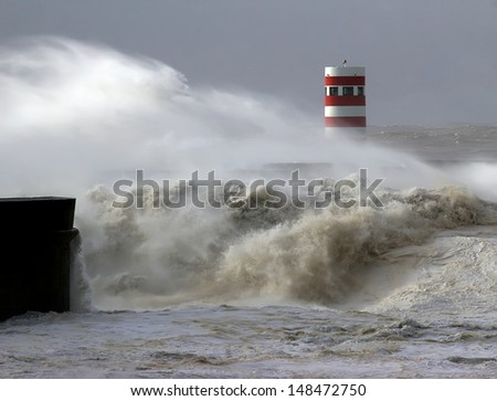 Dramatic wave during heavy storm weather conditions. - stock photo