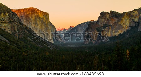 Dramatical sunrise of tunnel view with red peak of mountains, Yoemite national park - stock photo