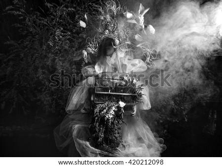Dramatized image of sensual girl symbolizing nature. Black-white art fashion outdoor photo. - stock photo