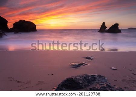 Dramtic sunset at Porthcothan Bay near Newquay, Cornwall England - stock photo