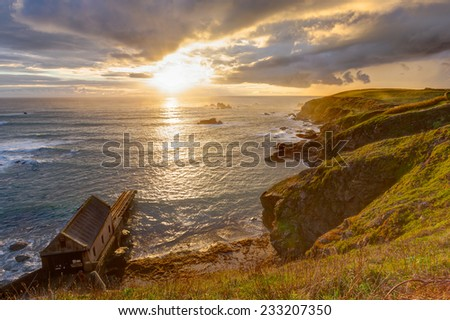Dramtic sunset over Polpeor Cove at Lizard Point Cornwall England UK Europe