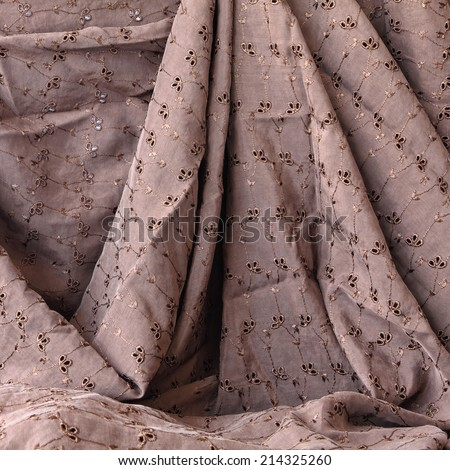 Drapery (creased)  embroidery fabric background or texture  - stock photo