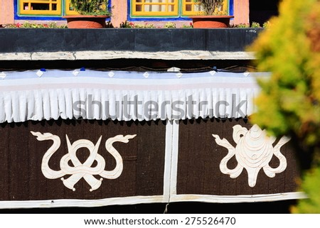 Drapery with Endless Knot and Conch Shell auspicious symbols in the courtyard of the Jokhang-House of Buddha temple. Lhasa-Tibet. - stock photo