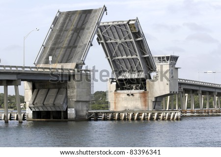 Draw bridge at gulf of Mexico in Florida opening for boat traffic