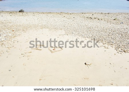 Draw I, heart (I love) in the beach - stock photo