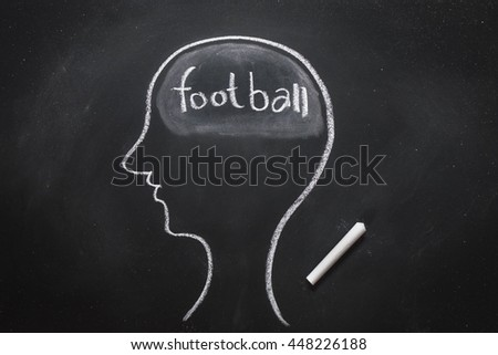 Draw the shape of a human head on the blackboard ( football in the brain ) - stock photo