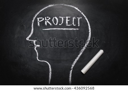 Draw the shape of a human head on the blackboard ( project in the brain ) - stock photo