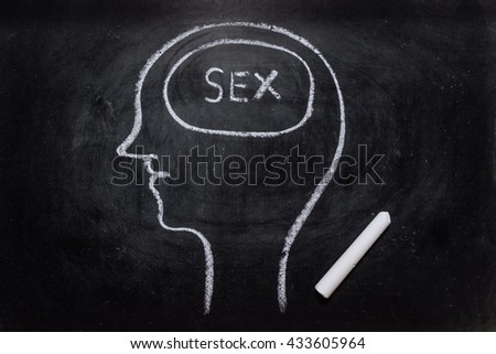Draw the shape of a human head on the blackboard ( sex in the brain ) - stock photo