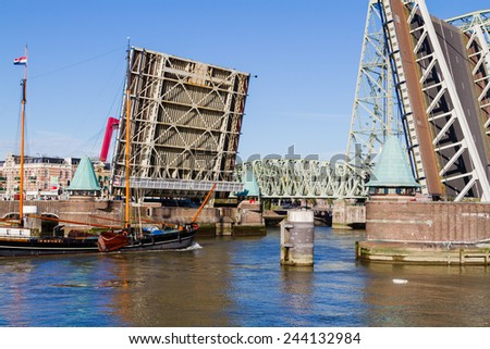 Drawbridge in an open position while the boat is passing by. Taken in Rotterdam, Netherlands - stock photo