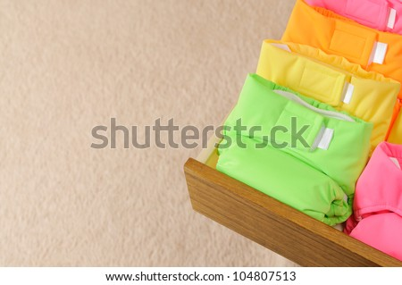 Drawer with multi-colored cloth diapers. With copyspace