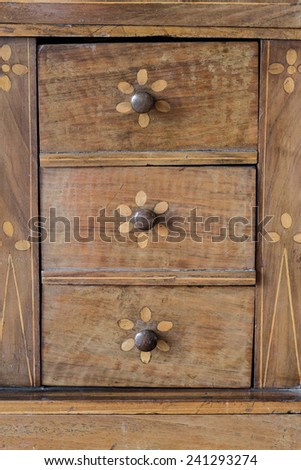 Drawers background, detail on old weathered wooden furniture - stock photo